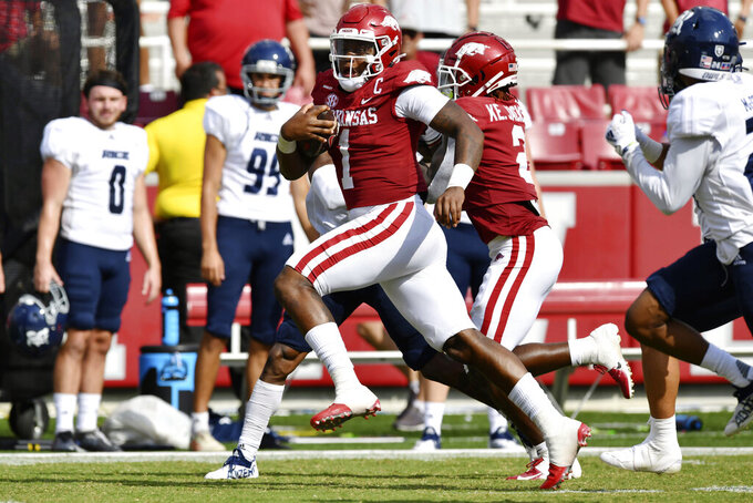 Arkansas quarterback KJ Jefferson (1) runs for a touchdown against Rice during the second half of an NCAA college football game Saturday, Sept. 4, 2021, in Fayetteville, Ark. (AP Photo/Michael Woods)