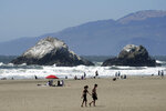 People visit Ocean Beach during the coronavirus outbreak in San Francisco, Sunday, July 5, 2020. Californians mostly heeded warnings to stay away from beaches and other public spaces during the long weekend as state officials urged social distancing amid a spike in coronavirus infections and hospitalizations. (AP Photo/Jeff Chiu)