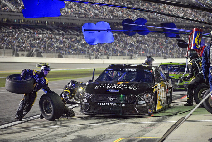 Cole Custer makes a pit stop for fuel and tires during a NASCAR Cup Series auto race at Daytona International Speedway, Saturday, Aug. 28, 2021, in Daytona Beach, Fla. (AP Photo/Phelan M. Ebenhack)