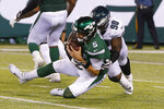Philadelphia Eagles' Treyvon Hester (90) sacks New York Jets quarterback Davis Webb (5) during the second half of a preseason NFL football game Thursday, Aug. 29, 2019, in East Rutherford, N.J. (AP Photo/Jim McIsaac)