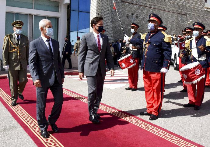 Tunisian Defense Minister Brahim Bartagi, left, welcomes U.S Secretary of Defense Mark Esper in Tunis Wednesday, Sept. 30, 2020. US Defense Secretary Mark Esper arrived Wednesday in Tunisia, before heading to Algeria and Morocco. (AP Photo/Hassene Dridi)