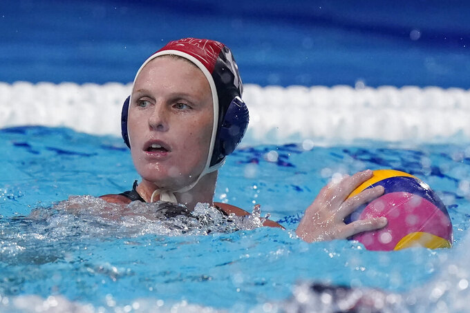 United States' goalkeeper Amanda Longan plays against Canada in the fourth quarter of a quarterfinal round women's water polo match at the 2020 Summer Olympics, Tuesday, Aug. 3, 2021, in Tokyo, Japan. It is her first game at the Olympics. (AP Photo/Mark Humphrey)