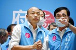 Mayor Han Kuo-yu, center, reacts as he speaks to the media in Kaohsiung, Taiwan, Saturday, June 6, 2020. Residents of the Taiwanese port city of Kaohsiung voted Saturday to oust their mayor, whose failed bid for the presidency on behalf of the China-friendly Nationalist Party earlier this year brought widespread disapproval among residents. (Kyodo News via AP)