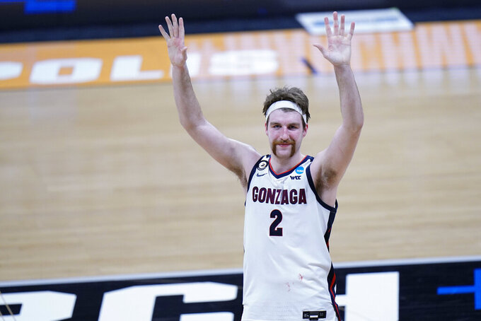 Gonzaga forward Drew Timme (2) reacts to the crowd cheering after defeating Oklahoma in a college basketball game in the second round of the NCAA tournament at Hinkle Fieldhouse in Indianapolis, Monday, March 22, 2021. (AP Photo/AJ Mast)