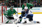 Dallas Stars goaltender Ben Bishop (30) gets help from right wing Corey Perry (10) defending against a shot attempt by Winnipeg Jets center Andrew Copp (9) in the second period of an NHL hockey game in Dallas, Thursday, Nov. 21, 2019. (AP Photo/Tony Gutierrez)