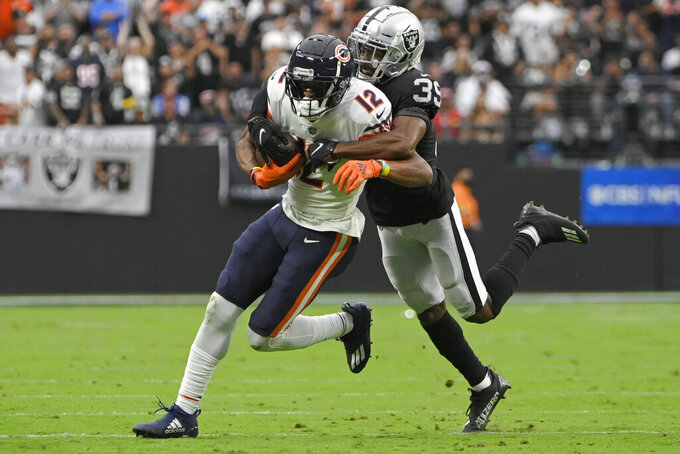 Las Vegas Raiders cornerback Nate Hobbs (39) tackles Chicago Bears wide receiver Allen Robinson (12) during the first half of an NFL football game, Sunday, Oct. 10, 2021, in Las Vegas. (AP Photo/David Becker)