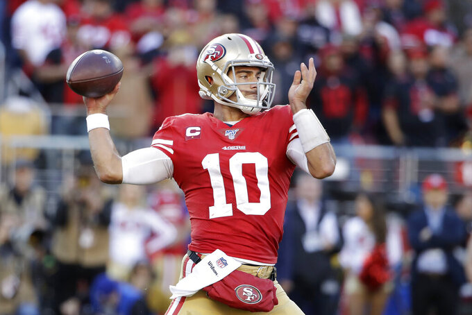 San Francisco 49ers quarterback Jimmy Garoppolo (10) passes against the Minnesota Vikings during the first half of an NFL divisional playoff football game, Saturday, Jan. 11, 2020, in Santa Clara, Calif. (AP Photo/Marcio Jose Sanchez)