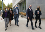 Toni Natalie, second from left, and India Oxenberg, right, arrive with their attorneys at Brooklyn federal court for a sentencing hearing for self-improvement guru Keith Raniere, Tuesday, Oct. 27, 2020 in New York. Raniere, whose organization NXIVM attracted millionaires and actresses among its adherents, is expected to be sentenced Tuesday on convictions that he turned some female followers into sex slaves branded with his initials. (AP Photo/Mark Lennihan)