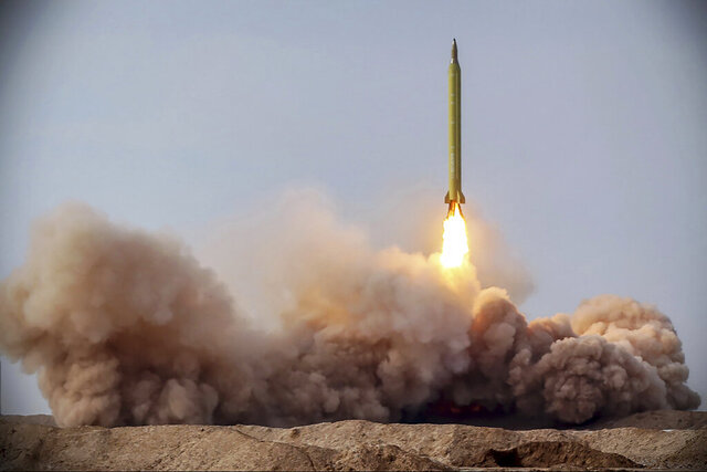In this photo released on Saturday, Jan. 16, 2021, by the Iranian Revolutionary Guard, a missile is launched in a drill in Iran. Iran's paramilitary Revolutionary Guard conducted a drill Saturday launching anti-warship ballistic missiles at a simulated target in the Indian Ocean, state television reported, amid heightened tensions over Tehran's nuclear program and a U.S. pressure campaign against the Islamic Republic. (Iranian Revolutionary Guard/Sepahnews via AP)