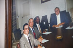 A photo of the late William Penn Troy Sr., second from right, and his fellow Marion County Council members, hangs on the wall of his office in Mullins, S.C., on Saturday, May 22, 2021. The funeral director died of COVID-19 in August 2020, one of many Black morticians to succumb during the pandemic. (AP Photo/Allen G. Breed)
