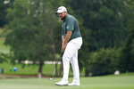 Shane Lowry, of Ireland, watches his putt on the ninth hole during the second round of the Wyndham Championship golf tournament at Sedgefield Country Club on Friday, Aug. 14, 2020, in Greensboro, N.C. (AP Photo/Chris Carlson)