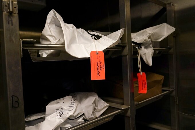 The bodies of a suspected migrants found dead in the desert await identification with limited remains at Medical Examiner's forensic labs in Tucson, Ariz., on Thursday, May 20, 2021. (AP Photo/Ross D. Franklin)