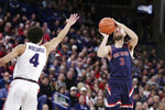 Saint Mary's guard Jordan Ford (3) shoots over Gonzaga guard Ryan Woolridge (4) during the first half of an NCAA college basketball game in Spokane, Wash., Saturday, Feb. 29, 2020. (AP Photo/Young Kwak)