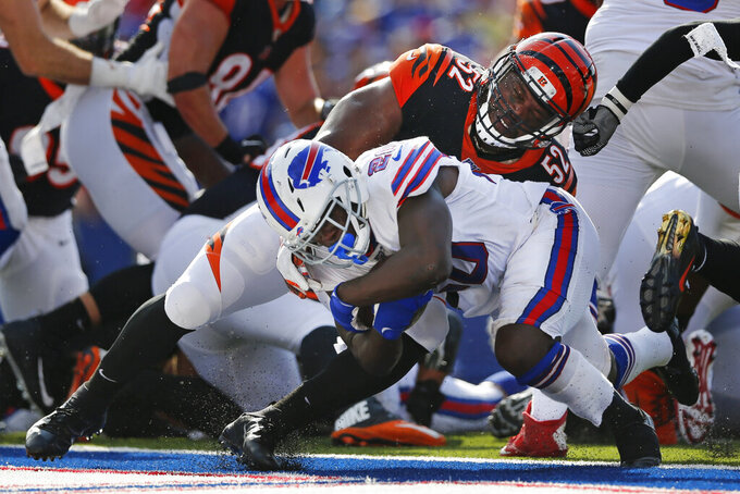 Buffalo Bills running back Frank Gore (20) pushes past Cincinnati Bengals' Preston Brown (52) for a touchdown during the second half of an NFL football game, Sunday, Sept. 22, 2019, in Orchard Park, N.Y. (AP Photo/John Munson)