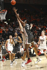 Washington State's Robert Franks Jr. shoots over Oregon State's Gligorije Rakocevic during the first half of an NCAA college basketball game in Corvallis, Ore., Thursday, Jan. 24, 2019. (AP Photo/Amanda Loman)