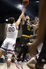Winthrop guard Chandler Vaudrin (52) shoots over Saint Mary's guard Tanner Krebs (00) during the second half of an NCAA college basketball game, Monday, Nov. 11, 2019 in Moraga, Calif. Winthrop upset 18th-ranked Saint Mary's 61-59. (AP Photo/D. Ross Cameron)