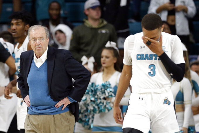 Coastal Carolina head coach Cliff Ellis, left, looks on as guard Devante Jones (3) reacts during the second half of an NCAA college basketball game against Baylor at the Myrtle Beach Invitational in Conway, S.C., Friday, Nov. 22, 2019. (AP Photo/Gerry Broome)