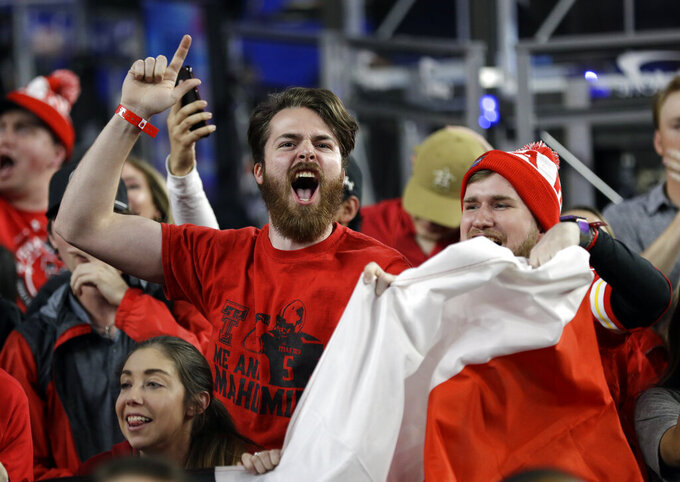 Texas Tech fans cheer before the semifinals of the Final Four NCAA college basketball tournament against Michigan State, Saturday, April 6, 2019, in Minneapolis. (AP Photo/David J. Phillip)