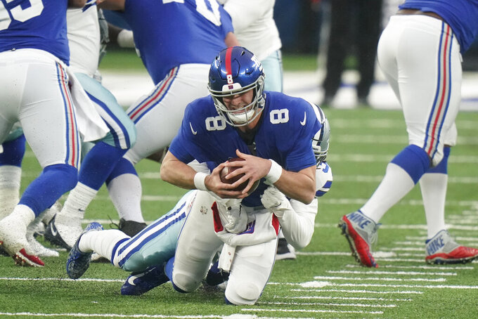 New York Giants quarterback Daniel Jones is sacked during the second half of an NFL football game against the Dallas Cowboys, Sunday, Jan. 3, 2021, in East Rutherford, N.J. (AP Photo/Frank Franklin II)