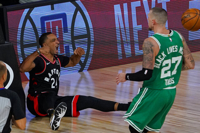 Toronto Raptors guard Norman Powell (24) celebrates after being fouled by Boston Celtics center Daniel Theis (27) during the second half of an NBA conference semifinal playoff basketball game Wednesday, Sept. 9, 2020, in Lake Buena Vista, Fla. (AP Photo/Mark J. Terrill)