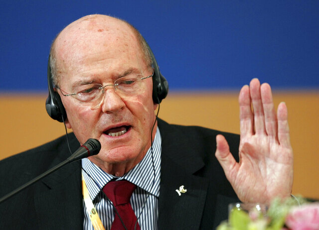FILE - In this April 10, 2008, file photo, Senior International Olympic Committee member Kevan Gosper speaks at a news conference in Beijing. Gosper, a former International Olympic Committee vice president, is suggesting the United Nations might be the place to decide the fate of the postponed Tokyo Olympic. They are to open on July 23, 2021, but face mounting opposition at home as COVID-19 cases surge in Tokyo, across Japan and across the globe. (AP Photo/Greg Baker, File)