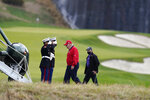 President Donald Trump walks to board Marine One after playing golf at Trump National Golf Club, Friday, Nov. 27, 2020, in Sterling, Va. (AP Photo/Alex Brandon)