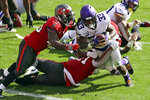 Minnesota Vikings running back Dalvin Cook (33) eludes a tackle by Tampa Bay Buccaneers inside linebacker Devin White (45) to score during the first half of an NFL football game Sunday, Dec. 13, 2020, in Tampa, Fla. (AP Photo/Mark LoMoglio)