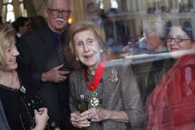 FILE - In this Nov. 13, 2009 file photo, U.S billionaire media proprietor Anne Cox Chambers, center, smiles after being awarded