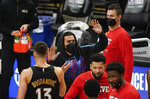 Atlanta Hawks' Trae Young, center, high-fives teammates during the first half of Game 4 of the NBA basketball Eastern Conference finals against the Milwaukee Bucks on Tuesday, June 29, 2021, in Atlanta. (AP Photo/Brynn Anderson)