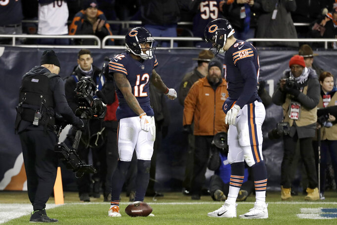 Chicago Bears wide receiver Allen Robinson (12) celebrates a touchdown with tight end Adam Shaheen (87) during the second half of an NFL wild-card playoff football game against the Philadelphia Eagles Sunday, Jan. 6, 2019, in Chicago. (AP Photo/Nam Y. Huh)