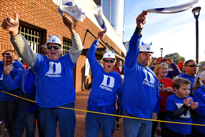 Duke fans greet the arrival of the Blue Devils before an NCAA college football game against Clemson, Saturday, Nov. 17, 2018, in Clemson, S.C. (AP Photo/Richard Shiro)