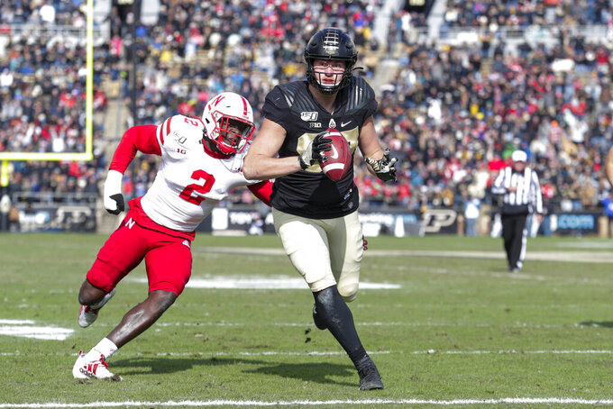 Purdue tight end Payne Durham (87) runs in for a touchdown in front of Nebraska linebacker Caleb Tannor (2) during the first half of an NCAA college football game in West Lafayette, Ind., Saturday, Nov. 2, 2019. (AP Photo/Michael Conroy)