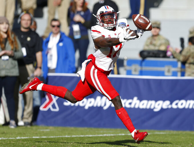 Houston wide receiver Terry Mark (17) cannot reach the pass thrown by quarterback Clayton Tune against Army during the first half of Armed Forces Bowl NCAA college football game Saturday, Dec. 22, 2018, in Fort Worth, Texas. (AP Photo/Jim Cowsert)