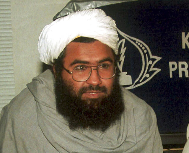 FILE- In this Feb 4, 2000 file photo, Pakistan-based militant leader Masood Azhar, speaks at the Karachi press club, in Pakistan. India's anti-terrorism agency named the Pakistan-based militant leader as the prime mastermind in a 2019 car bombing in Indian-controlled Kashmir that killed 40 Indian soldiers and brought two nuclear-armed rival nations to the brink of war, officials said Wednesday. (AP Photo/Zia Mazhar, File)