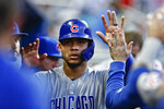 Chicago Cubs' Willson Contreras (40) celebrates in the dugout after he scored during the second inning of the team's baseball game against the Miami Marlins on Wednesday, April 17, 2019, in Miami. (AP Photo/Brynn Anderson)