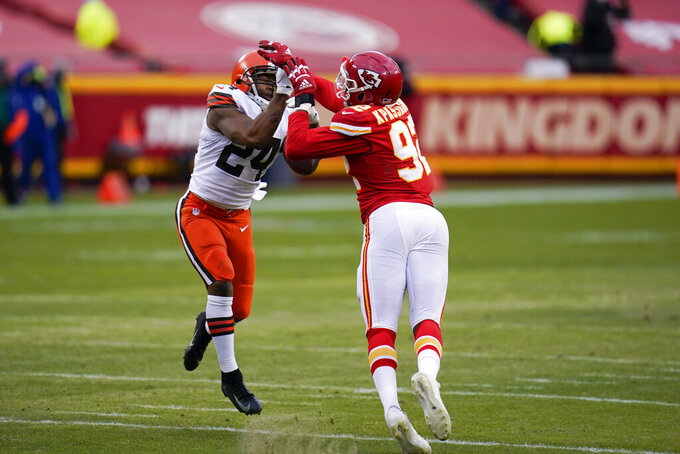 Kansas City Chiefs defensive end Tanoh Kpassagnon breaks up a pass intended for Cleveland Browns running back Nick Chubb (24) during the second half of an NFL divisional round football game, Sunday, Jan. 17, 2021, in Kansas City. (AP Photo/Jeff Roberson)