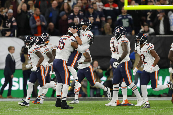 Chicago Bears quarterback Chase Daniel (4) celebrates with tight end Bradley Sowell (85) following a touchdown during the second half of an NFL football game against the Oakland Raiders at Tottenham Hotspur Stadium, Sunday, Oct. 6, 2019, in London. (AP Photo/Kirsty Wigglesworth)