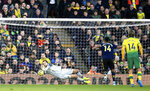 Norwich City goalkeeper Tim Krul, left, saves a penalty shot from Arsenal's Pierre-Emerick Aubameyang, second right, during their English Premier League soccer match at Carrow Road in Norwich, England, Sunday Dec. 1, 2019. (Adam Davy/PA via AP)