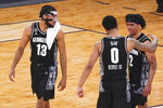 Georgetown guard Jahvon Blair (0) guard Dante Harris (2) and guard Donald Carey (13) celebrate after defeating Villanova in an NCAA college basketball game in the quarterfinals of the Big East conference tournament, Thursday, March 11, 2021, in New York. Georgetown won 72-71. (AP Photo/Mary Altaffer)