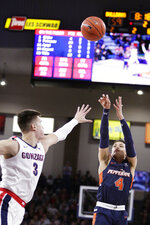 Pepperdine guard Colbey Ross (4) shoots over Gonzaga forward Filip Petrusev (3) during the second half of an NCAA college basketball game in Spokane, Wash., Saturday, Jan. 4, 2020. Gonzaga won 75-70. (AP Photo/Young Kwak)