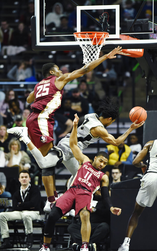 Wake Forest's Sharon Wright, Jr. (2) drives to the basket as Florida State's Mfiondu Kabengele (25) and (11) David Nichols defend during the second half of an NCAA college basketball game on Saturday, March 9, 2019 in Winston-Salem, N.C. Florida State beat Wake Forest 65 to 57. (AP Photo/Woody Marshall)