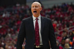 FILE - Louisville head coach Chris Mack reacts to a play during the second half of an NCAA college basketball game against Virginia Tech, Sunday, March 1, 2020 in Louisville, Ky. (AP Photo/Bryan Woolston, File)
