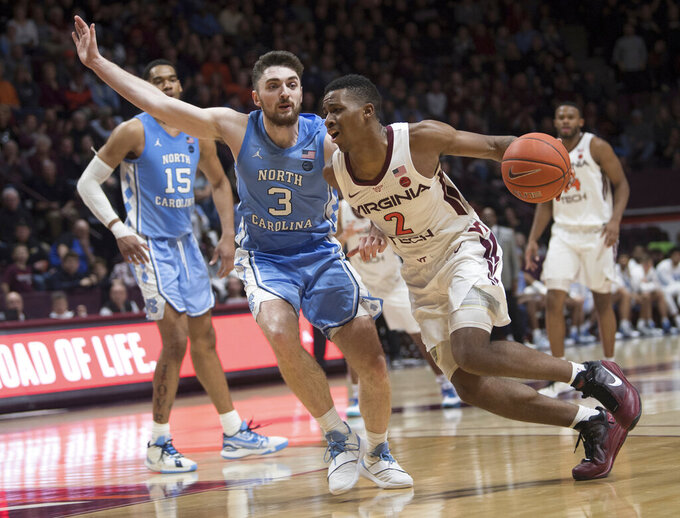 Virginia Tech guard Landers Nolley II drives around North Carolina defender Andrew Platek (3) during the second half of an NCAA college basketball game in Blacksburg, Va., Wednesday, Jan. 22, 2020.(AP Photo/Lee Luther Jr.)