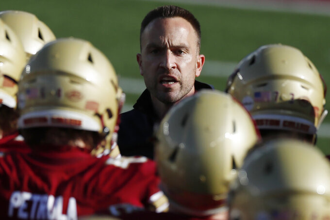 Boston College head coach Jeff Hafley talks to his team during the first half of an NCAA college football game against North Carolina, Saturday, Oct. 3, 2020, in Boston. (AP Photo/Michael Dwyer)