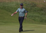 United States' Brian Harman reacts after putting on the 2nd green during the first round British Open Golf Championship at Royal St George's golf course Sandwich, England, Thursday, July 15, 2021. (AP Photo/Ian Walton)