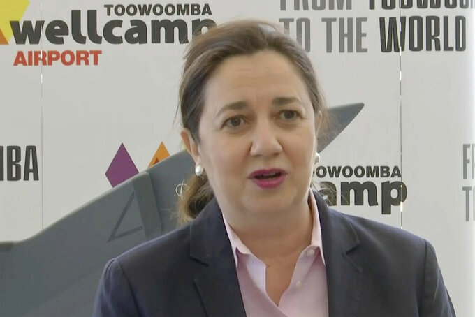 In this image made from video, Queensland State Premier Annastacia Palaszczuk speaks during a press conference in Toowoomba, Australia, Wednesday, Sept. 22, 2021. Chicago-based aerospace giant Boeing has announced plans to build a new type of drone military aircraft in Australia. Boeing said Wednesday it has selected Toowoomba city in Queensland state as the final assembly point for its unmanned Loyal Wingman planes. The first test flights were completed earlier this year. (Australian Broadcasting Corporation via AP)