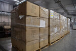 In this March 28, 2020 photo provided by the United Nations, pallets containing 250,000 face masks rest on a landing dock at United Nations headquarters. On Saturday, New York Mayor Bill de Blasio accepted the masks from the U.N. for use in the city's battle against the coronavirus. (Eskinder Debebe/The United Nations via AP)