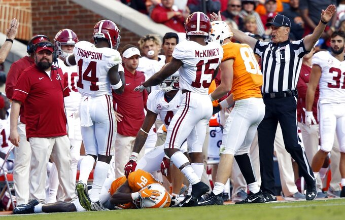 Tennessee wide receiver Josh Palmer (84) lays on the ground after being injured on a play in the first half of an NCAA college football game against Alabama Saturday, Oct. 20, 2018, in Knoxville, Tenn. (AP Photo/Wade Payne)