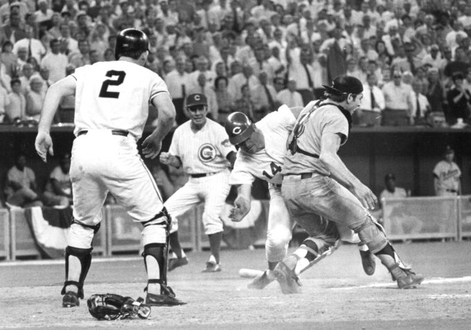 FILE - In this July 14, 1970, file photo, National League's Pete Rose slams into American League catcher Ray Fosse to score the winning run during the 12th inning of the baseball All-Star Game in Cincinnati. Looking on are third base coach Leo Durocher, and on-deck batter Dick Dietz (2). Fosse, the strong-armed catcher whose career was upended when he was bowled over by Rose in the All-Star Game, has died. He was 74. Carol Fosse, his wife of 51 years, said in a statement Fosse died Wednesday, Oct. 13, 2021, after a 16-year bout with cancer. (AP Photo, File)