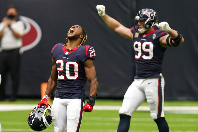 Houston Texans strong safety Justin Reid (20) and defensive end J.J. Watt (99) celebrate their win over the New England Patriots in an NFL football game, Sunday, Nov. 22, 2020, in Houston. (AP Photo/David J. Phillip)